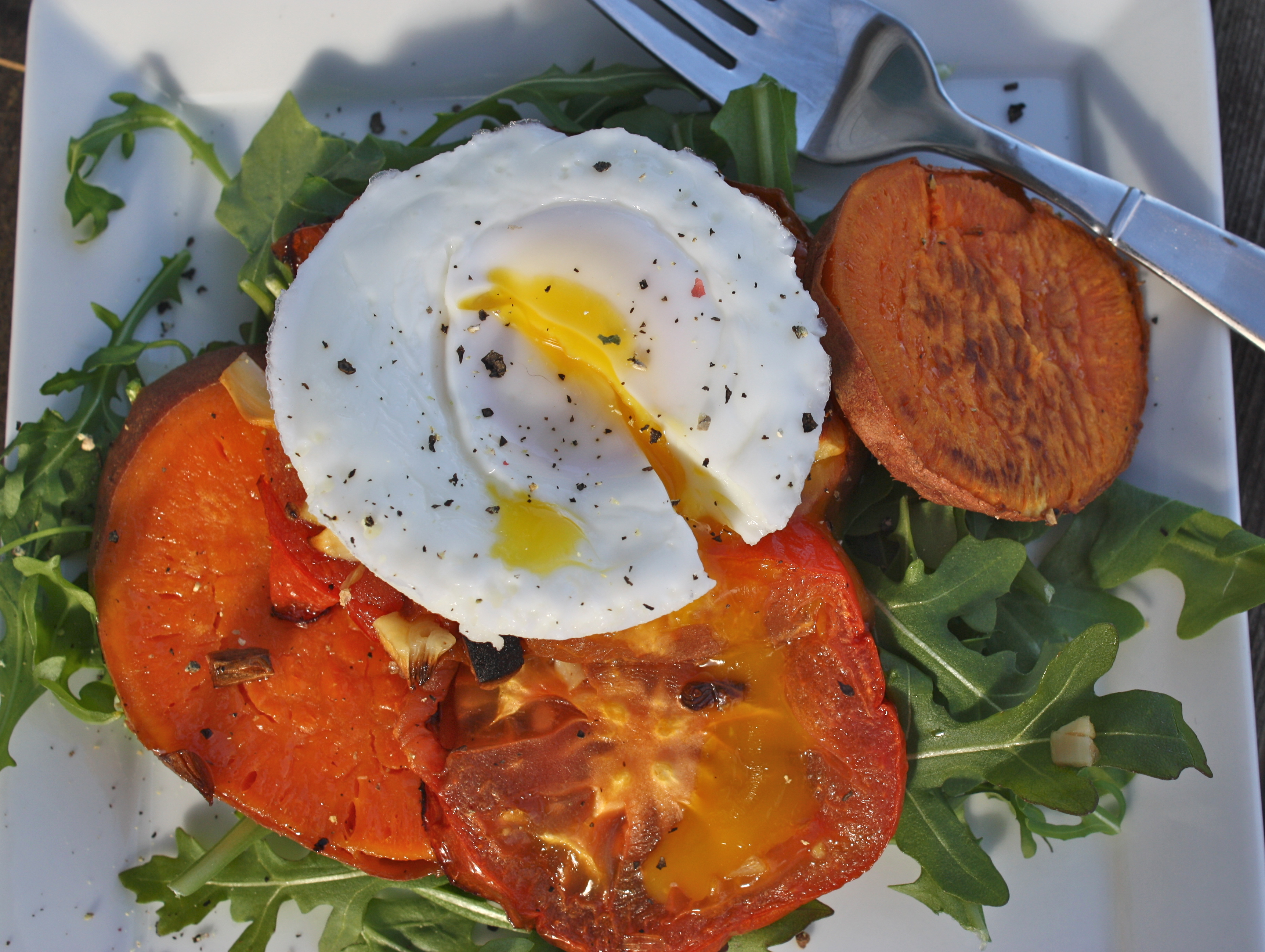 roasted garlic sweet potatoes and tomatoes with poached egg - Dishing ...